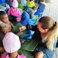 Volunteer teaching young children at a local pre-school
